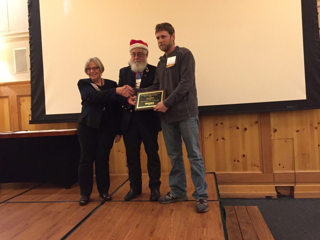 Clallam County PUD Journeyman Lineman Joe Helvey (right) is presented the Good Samaritan Award by Washington Public Utility Districts Association President Dennis Reid (middle) and Pacific County PUD Commissioner Diana Thompson (left).